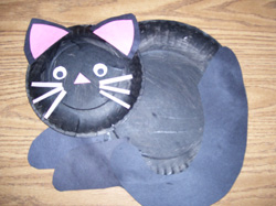 Paint a large and small paper plate black or any other cat colors. Give the children construction paper scraps. Have them create cats. & Cat Paper Plate Paint
